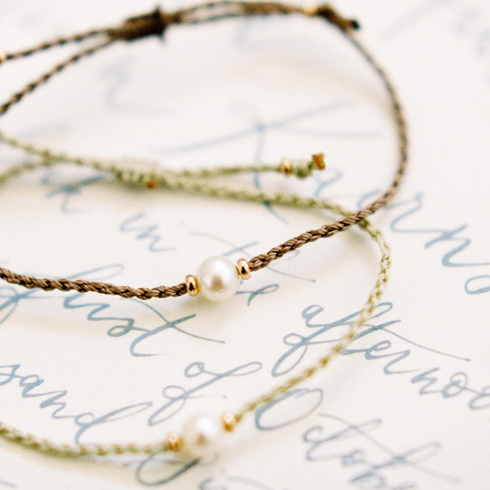 An akoya pearl and gold bead bracelet