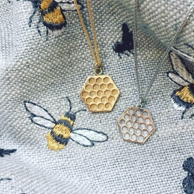 A gold �Hive� pendant