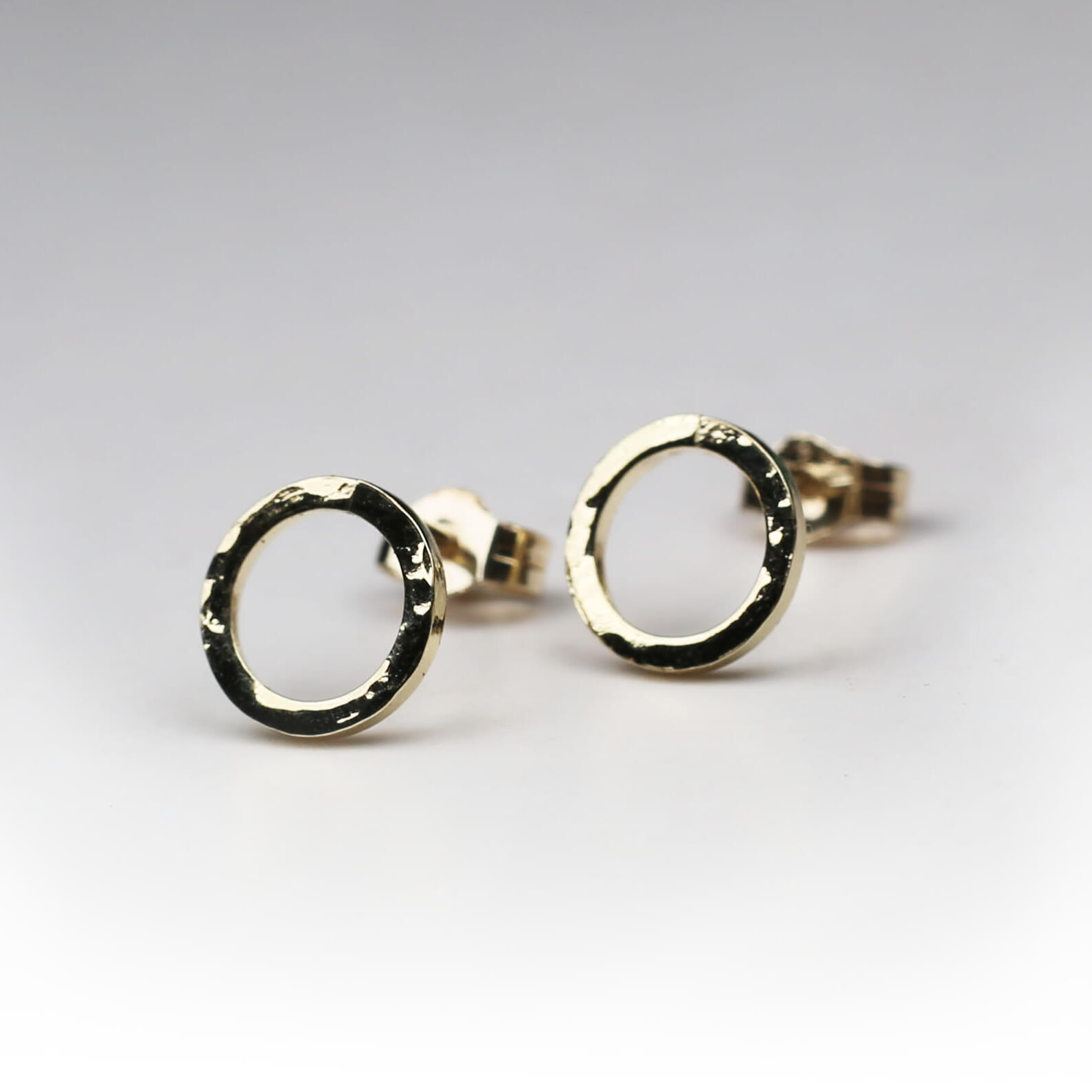 Yellow gold hammered circle studs